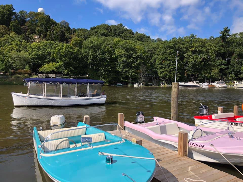 Duffy behind retro boats