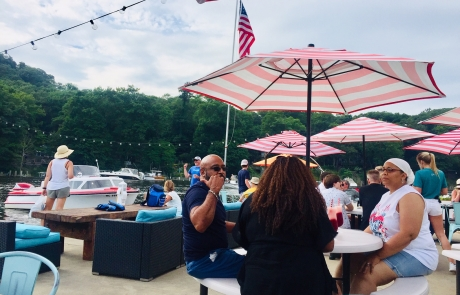Relax with friends on the Old Boat House patio on the Kalamazoo river